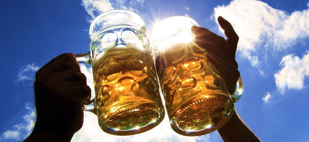 Revellers salute with beer during Oktoberfest in Munich